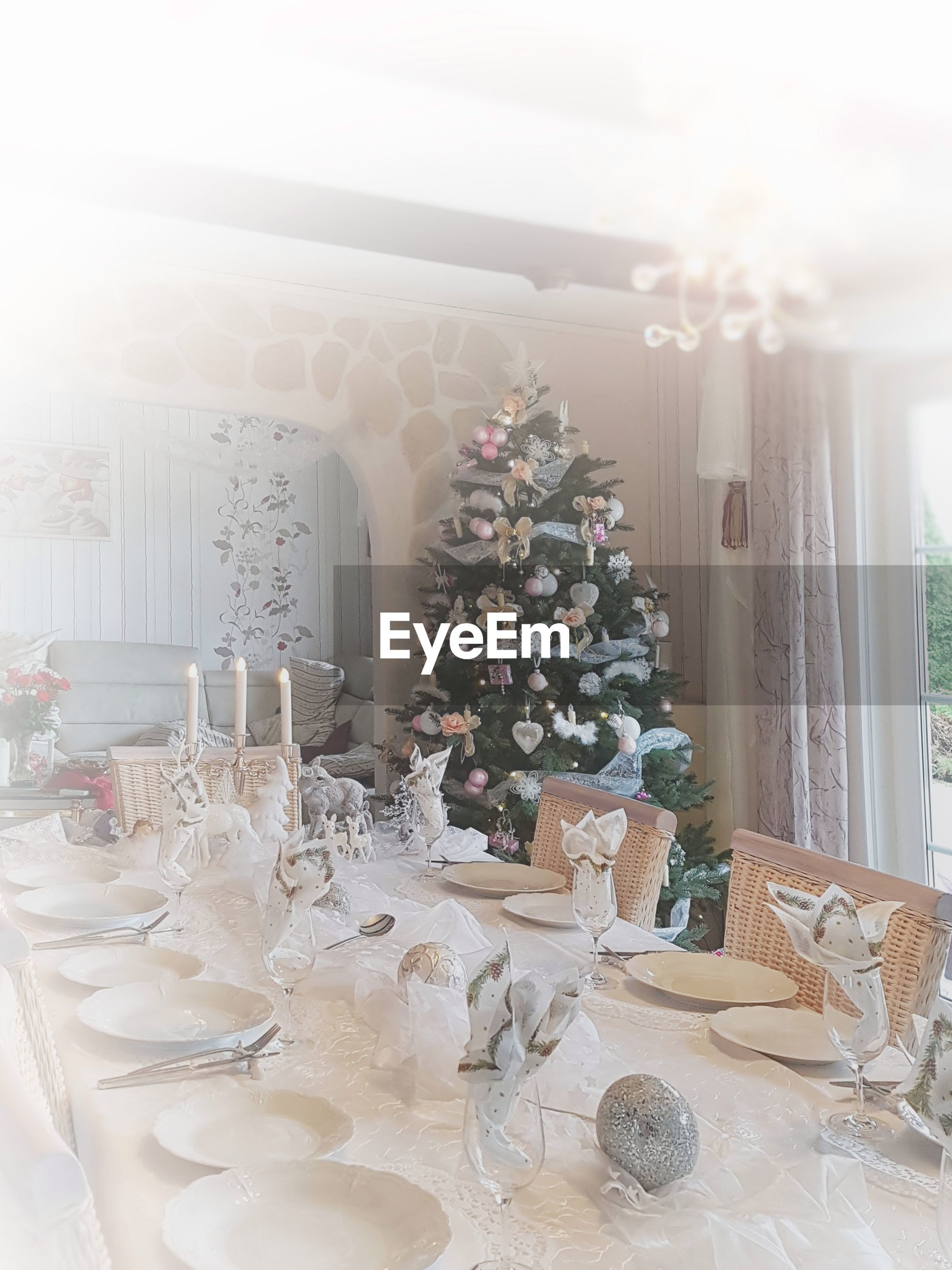Place setting on dining table during christmas at home