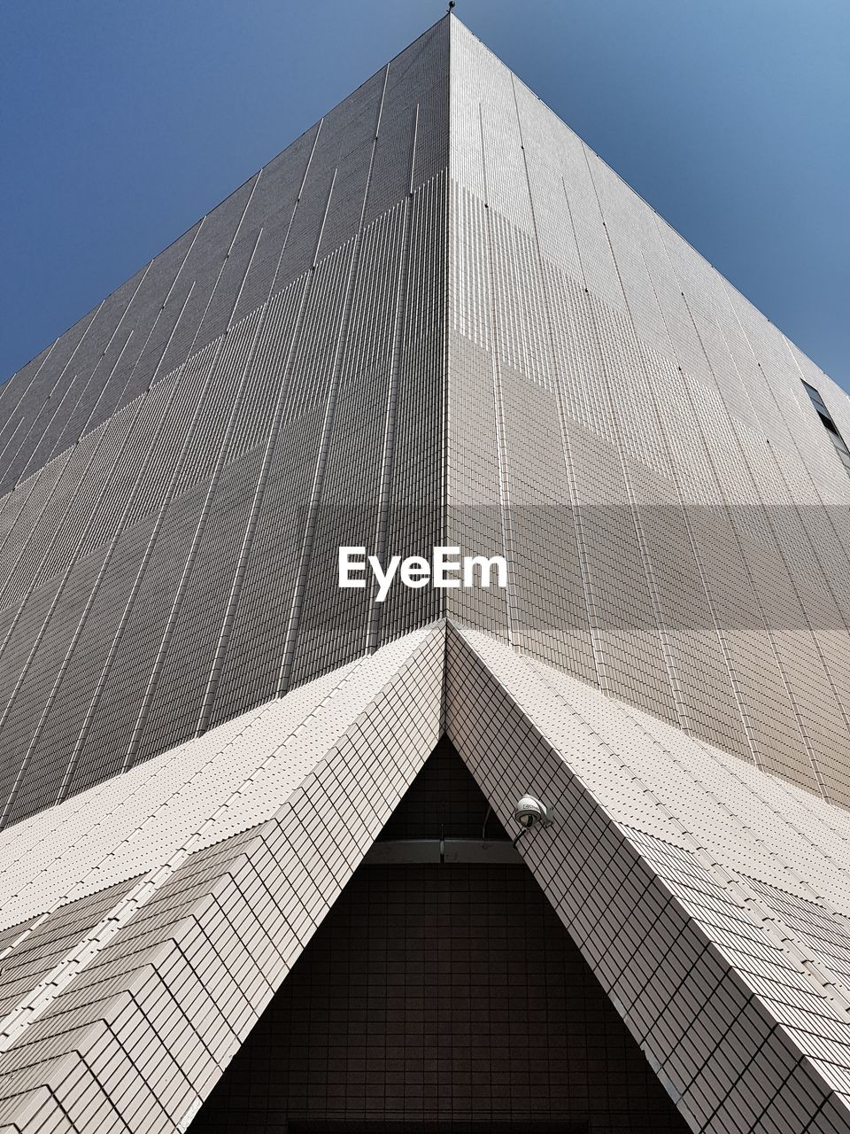 architecture, built structure, building exterior, sky, low angle view, modern, building, clear sky, no people, office building exterior, travel destinations, day, city, office, nature, tall - high, pattern, tourism, shape, skyscraper, directly below