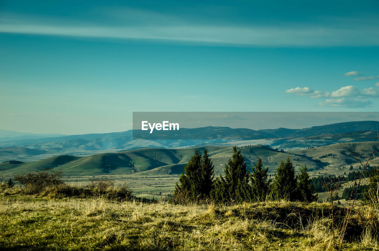 mountain, nature, landscape, scenics, tranquil scene, beauty in nature, sky, no people, mountain range, tranquility, day, blue, outdoors, grass