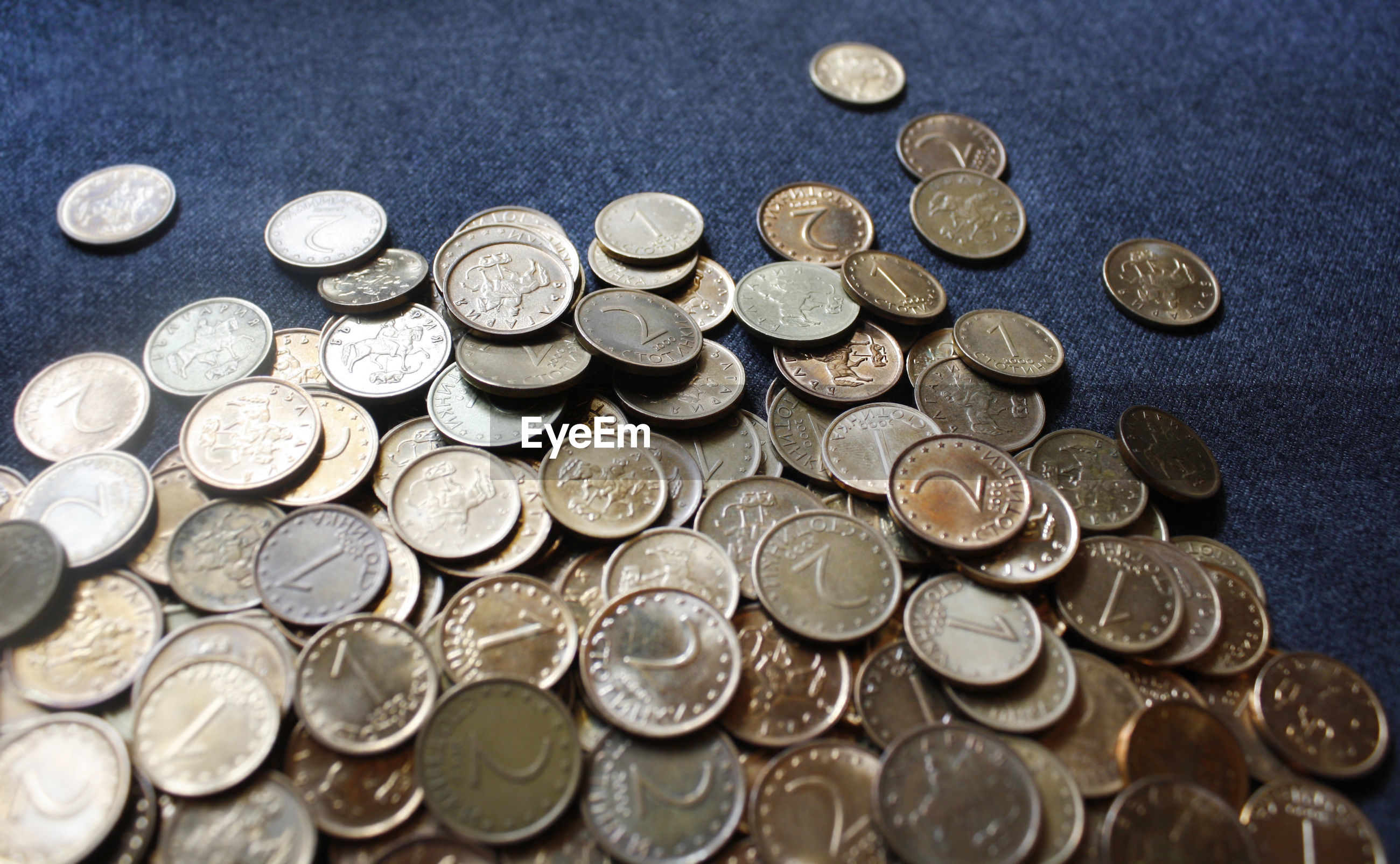 High angle view of golden coins on table