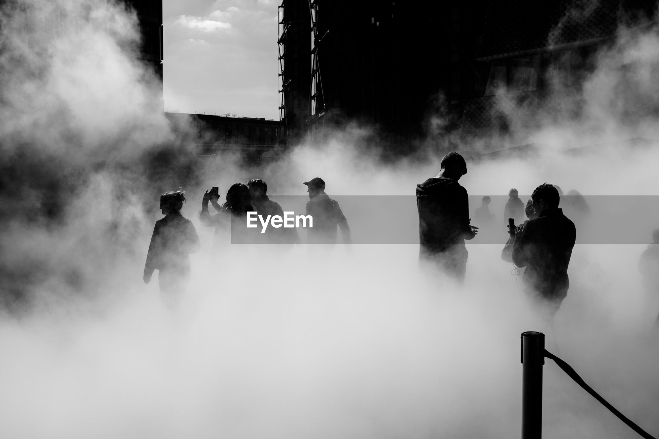 People surrounded by smoke