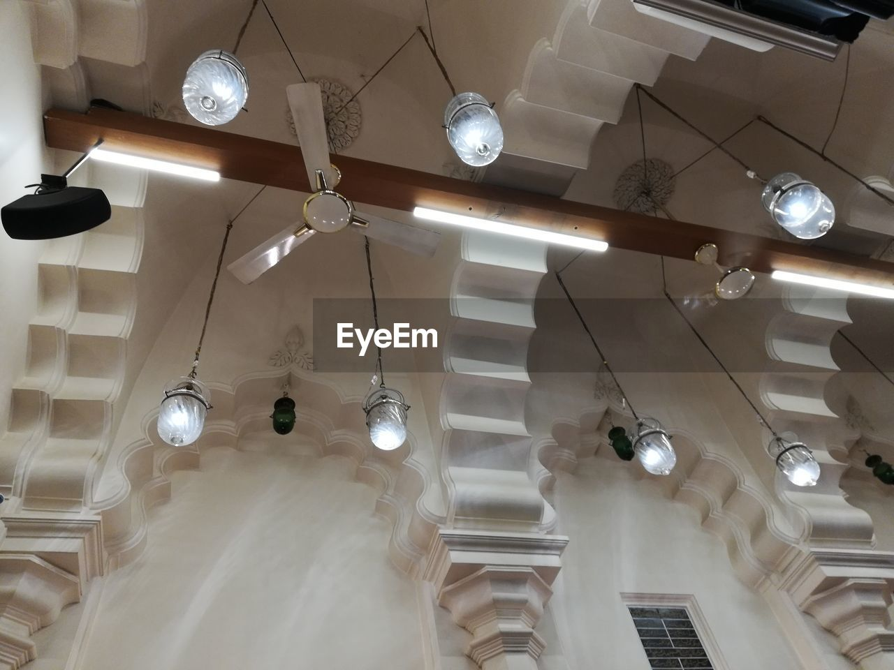 lighting equipment, ceiling, hanging, indoors, low angle view, illuminated, light, decoration, chandelier, pendant light, no people, electric light, architecture, electricity, built structure, home interior, modern, group, glowing, light fixture, electric lamp, luxury, ornate