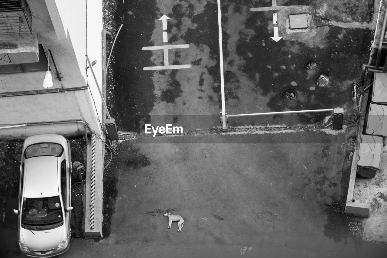 High Angle View Of Parked Vehicle Against Built Structure