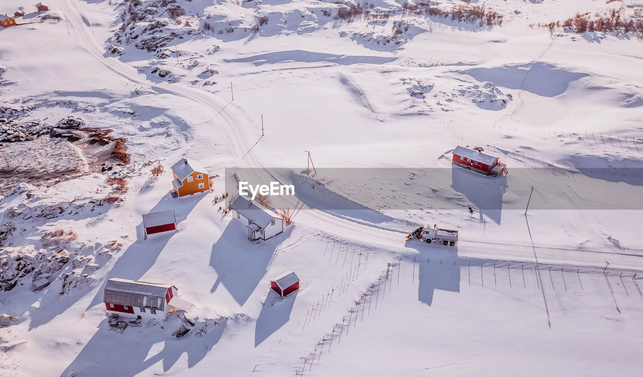 snow, cold temperature, winter, high angle view, mountain, nature, covering, scenics - nature, environment, day, sport, architecture, landscape, white color, beauty in nature, field, no people, land, winter sport, outdoors, snowcapped mountain