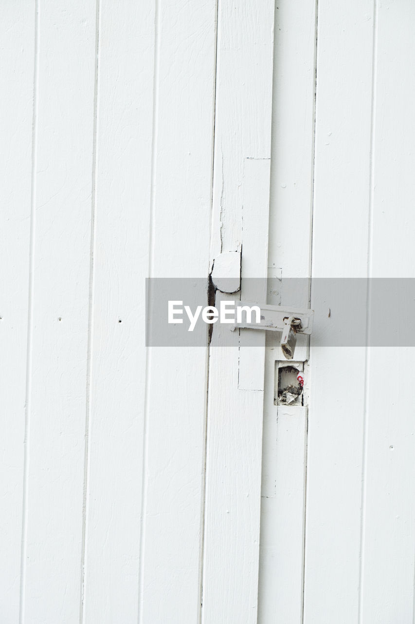 built structure, door, entrance, white color, protection, architecture, no people, security, wall - building feature, wood - material, safety, day, closed, close-up, full frame, white, outdoors, metal, backgrounds, building exterior, latch