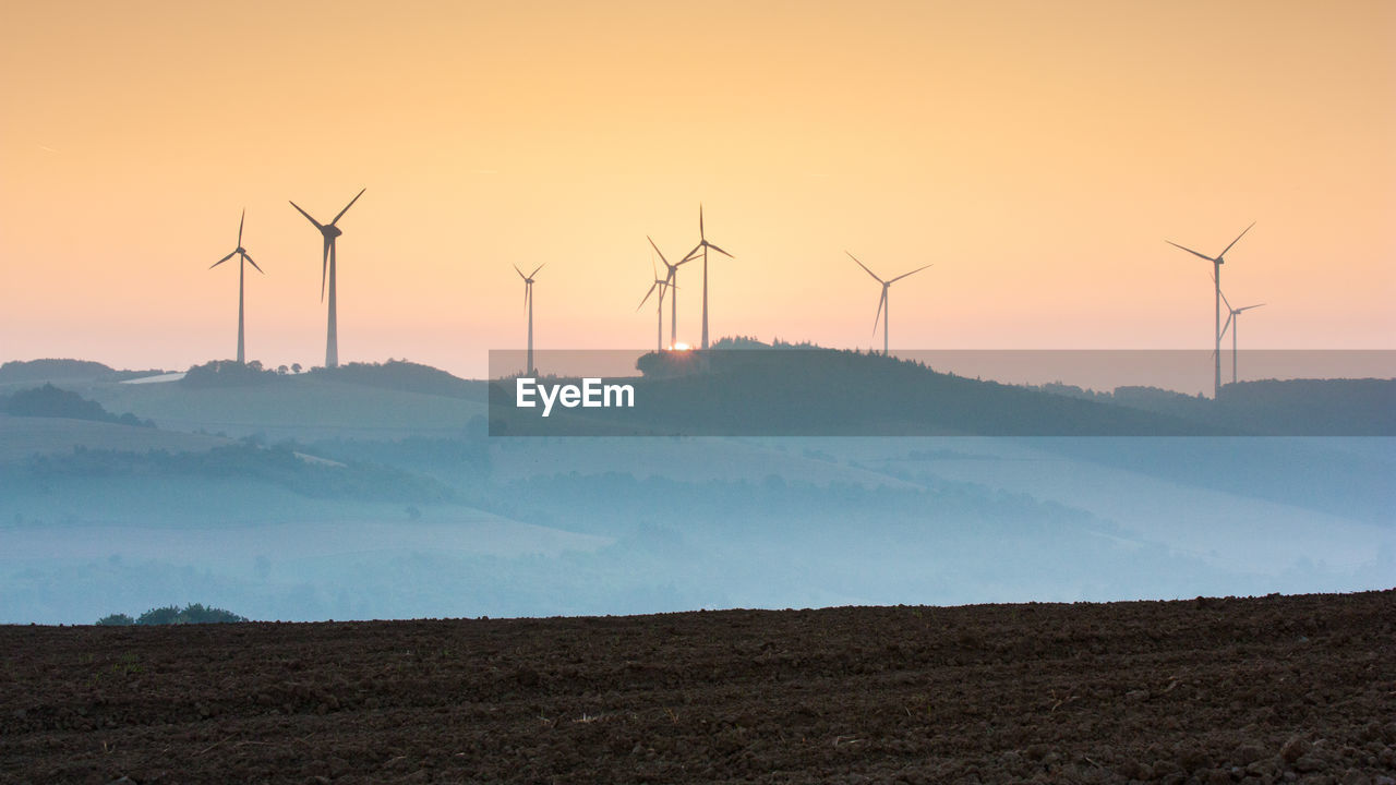environment, fuel and power generation, renewable energy, environmental conservation, turbine, sunset, alternative energy, wind turbine, wind power, landscape, scenics - nature, land, sky, beauty in nature, technology, nature, field, orange color, tranquility, no people, sustainable resources, power supply