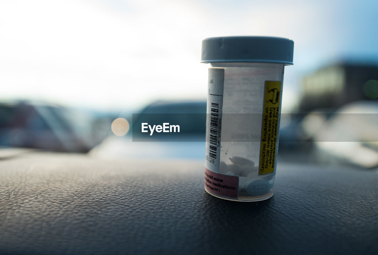 Close-up of pill bottle in car