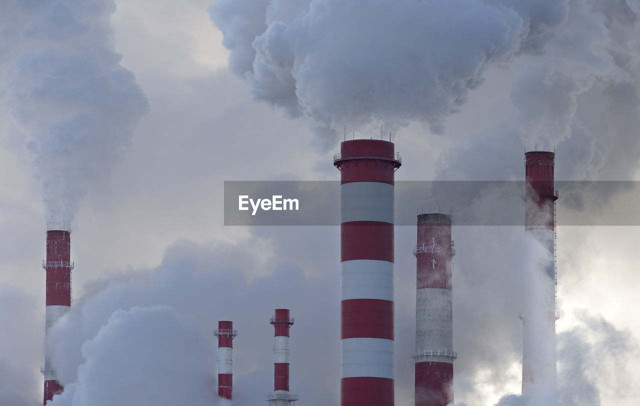 Panoramic View Of Smoke Stack Against Sky