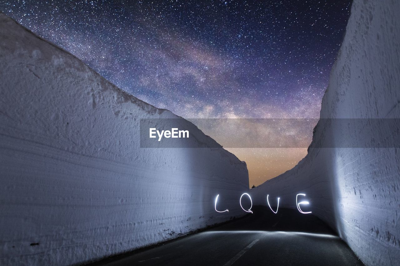 """Light Painting Of The Word """"love"""" On Road At Night"""