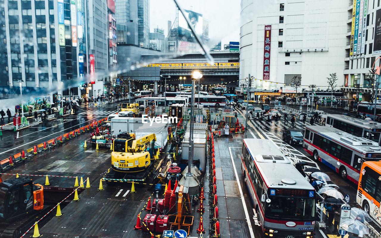 High angle view of traffic on city street during rainy season