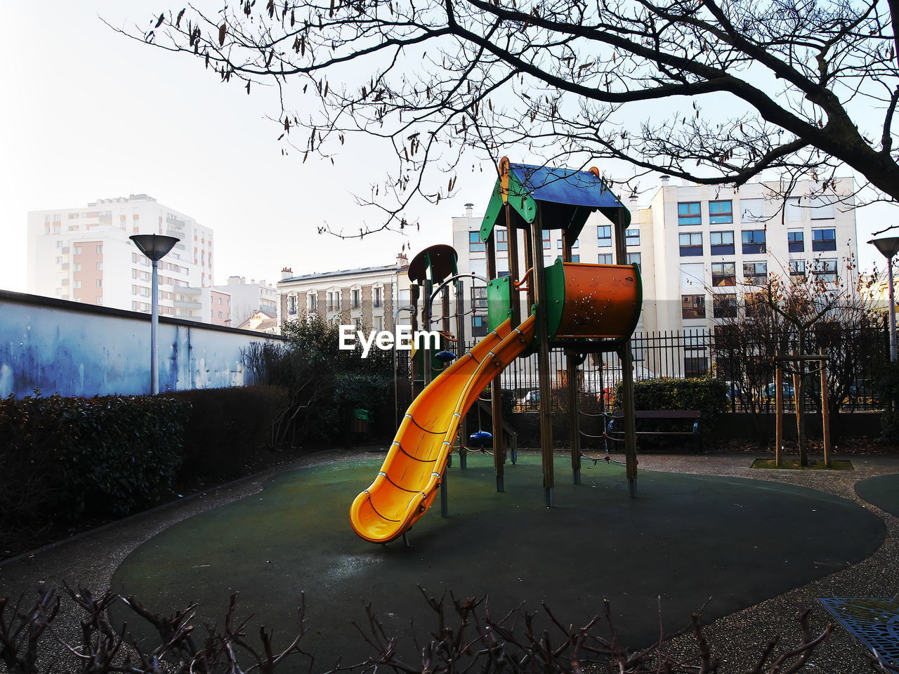 VIEW OF PLAYGROUND AGAINST TREES