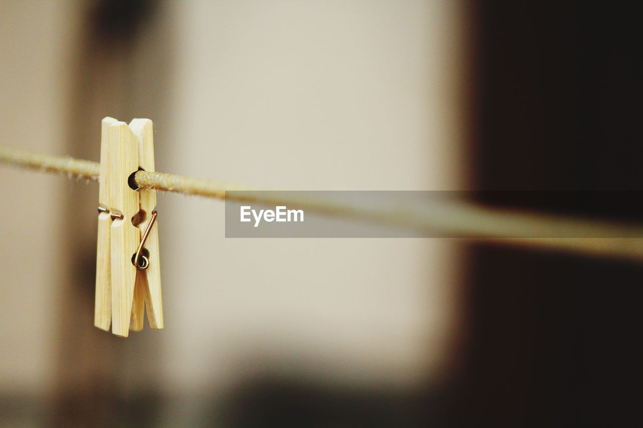 close-up, clothesline, focus on foreground, metal, clothespin, rope, hanging, no people, selective focus, day, safety, lock, protection, wall - building feature, security, outdoors, clothing, string, nature, hope - concept