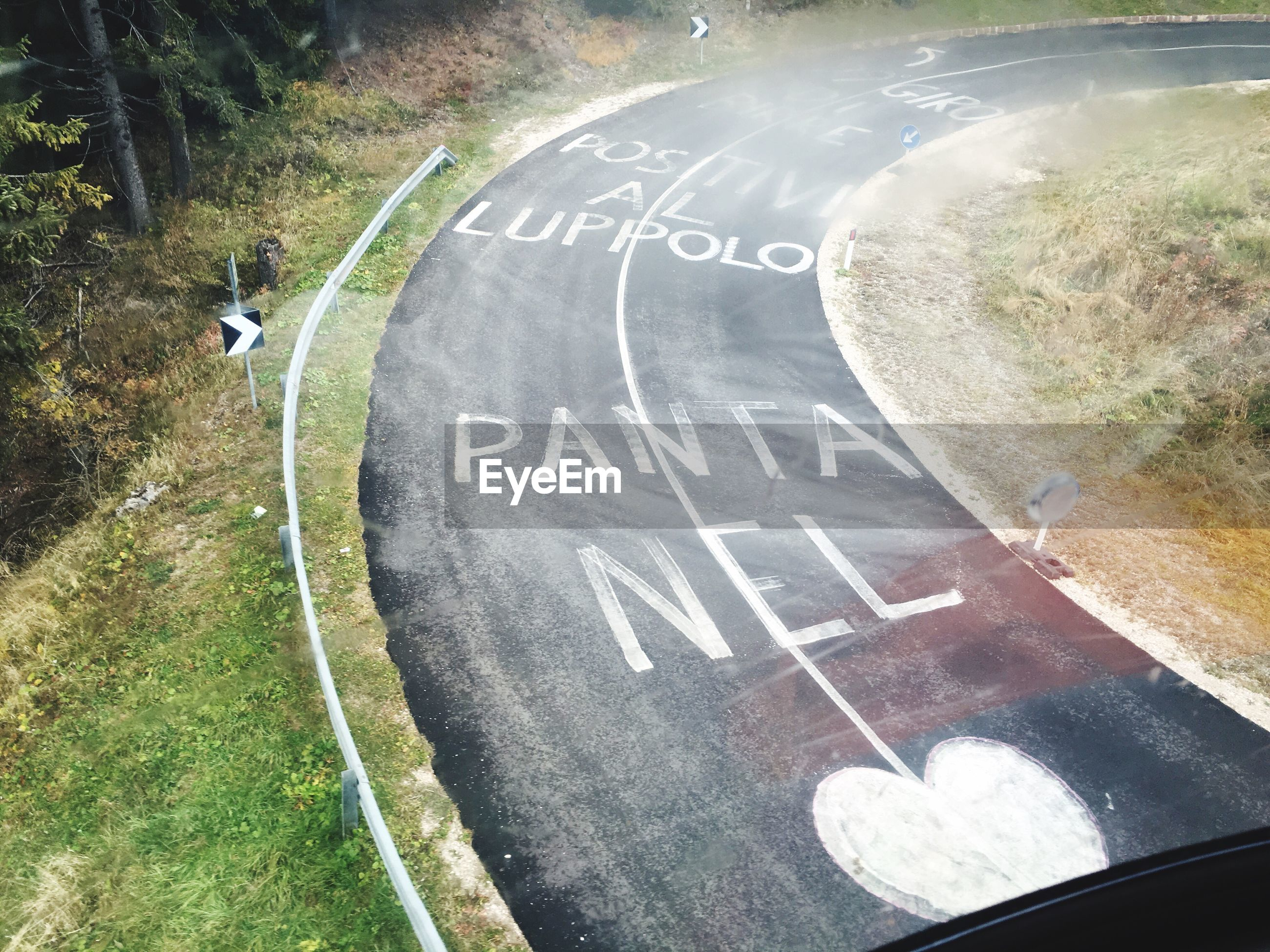 High angle view of text on road by field