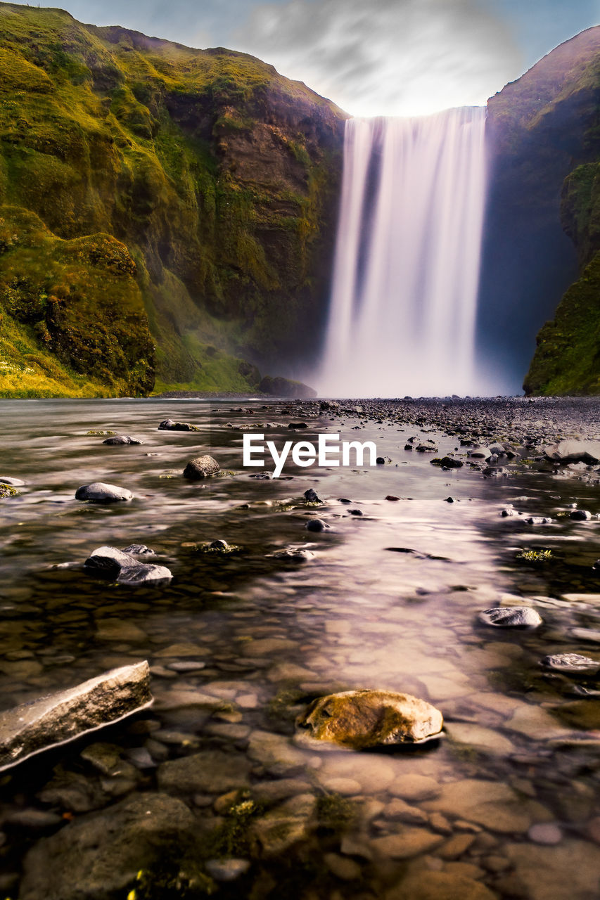 water, scenics - nature, long exposure, waterfall, beauty in nature, motion, blurred motion, rock, flowing water, flowing, rock - object, nature, solid, no people, land, non-urban scene, day, environment, idyllic, power in nature, outdoors, stream - flowing water, falling water, purity