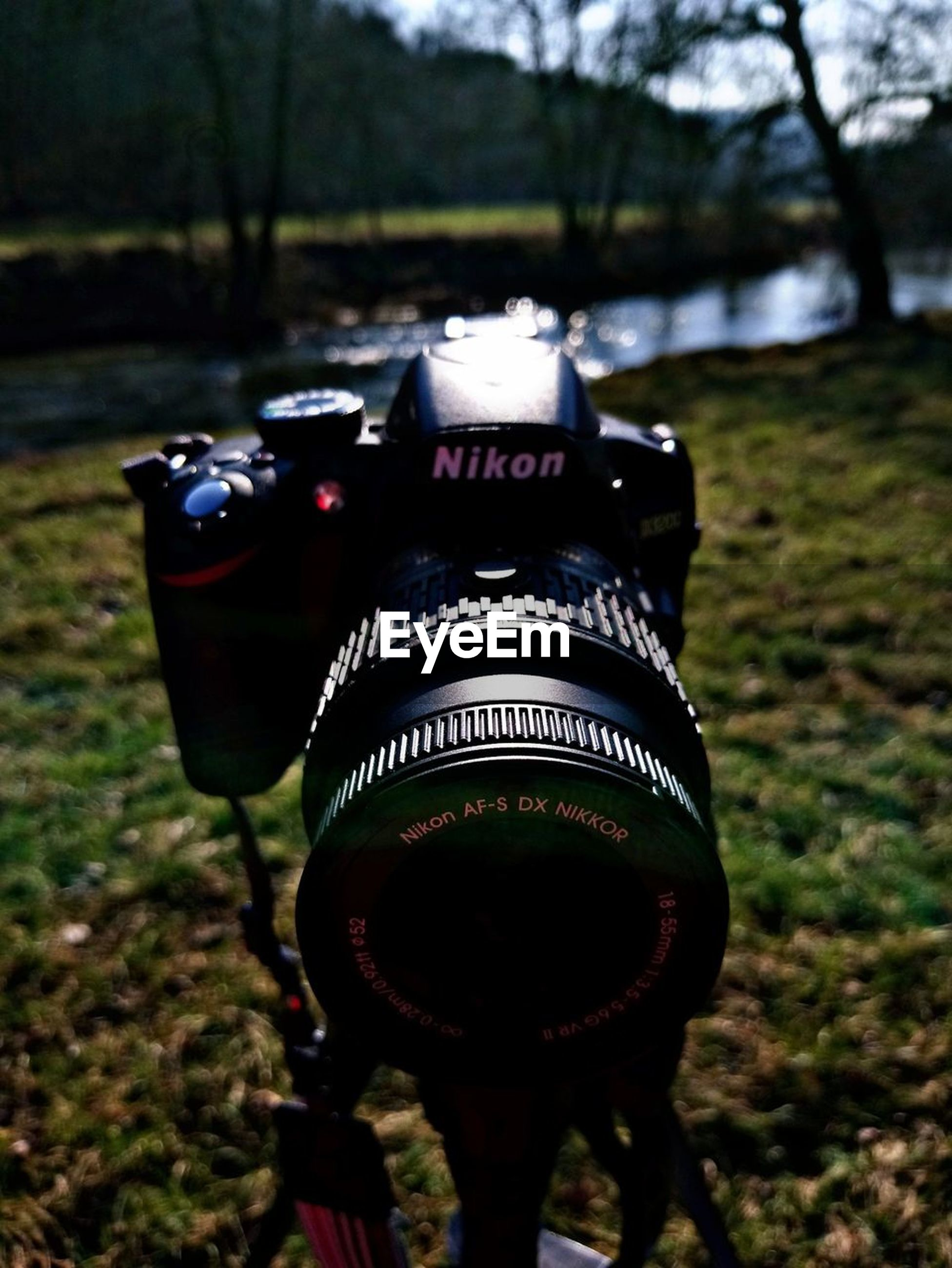 focus on foreground, field, outdoors, tree, no people, camera - photographic equipment, close-up, day, technology