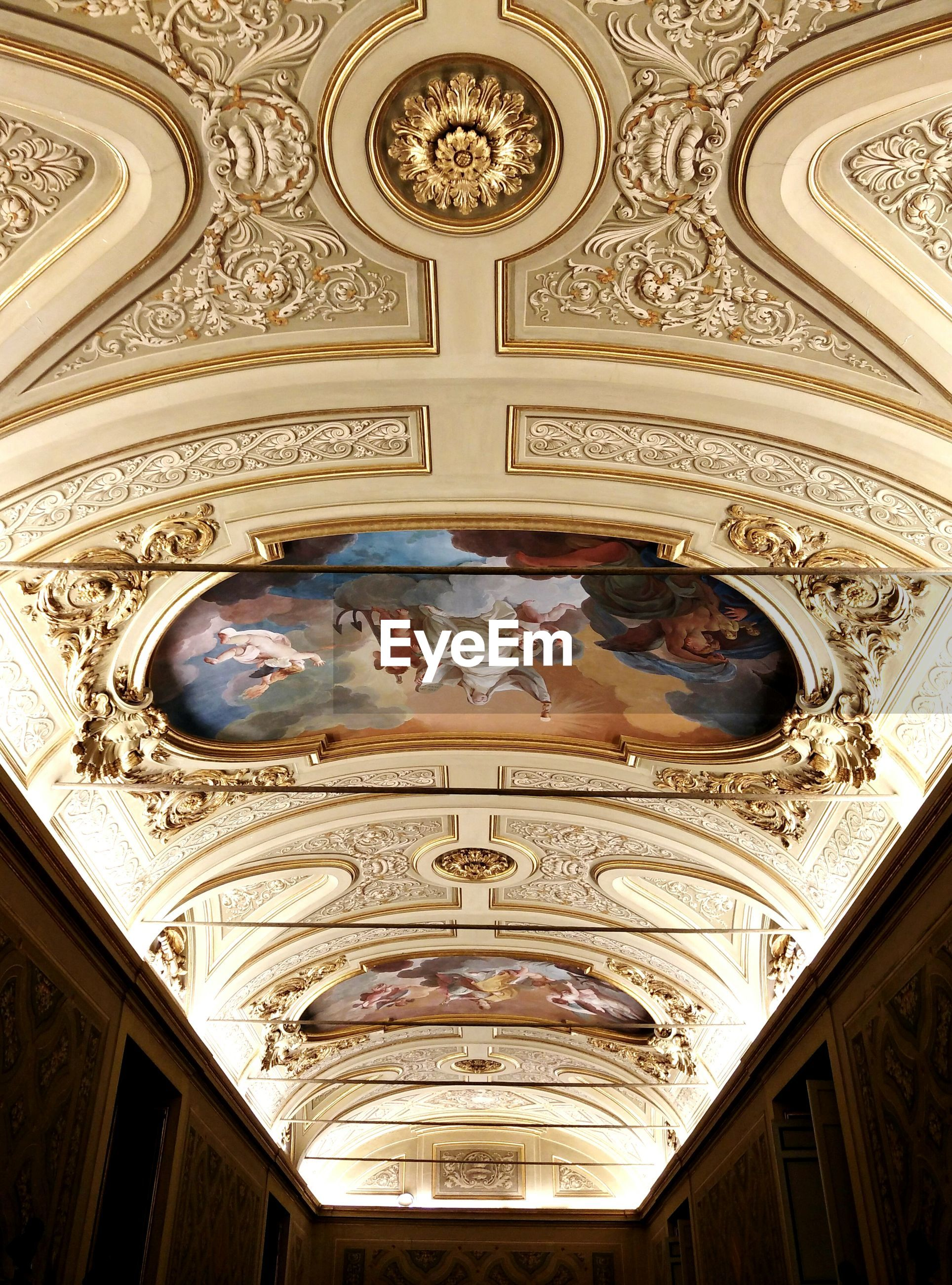 indoors, architecture, built structure, ornate, low angle view, art and craft, art, design, ceiling, famous place, creativity, arch, architectural feature, history, religion, place of worship, travel destinations, carving - craft product, international landmark, pattern