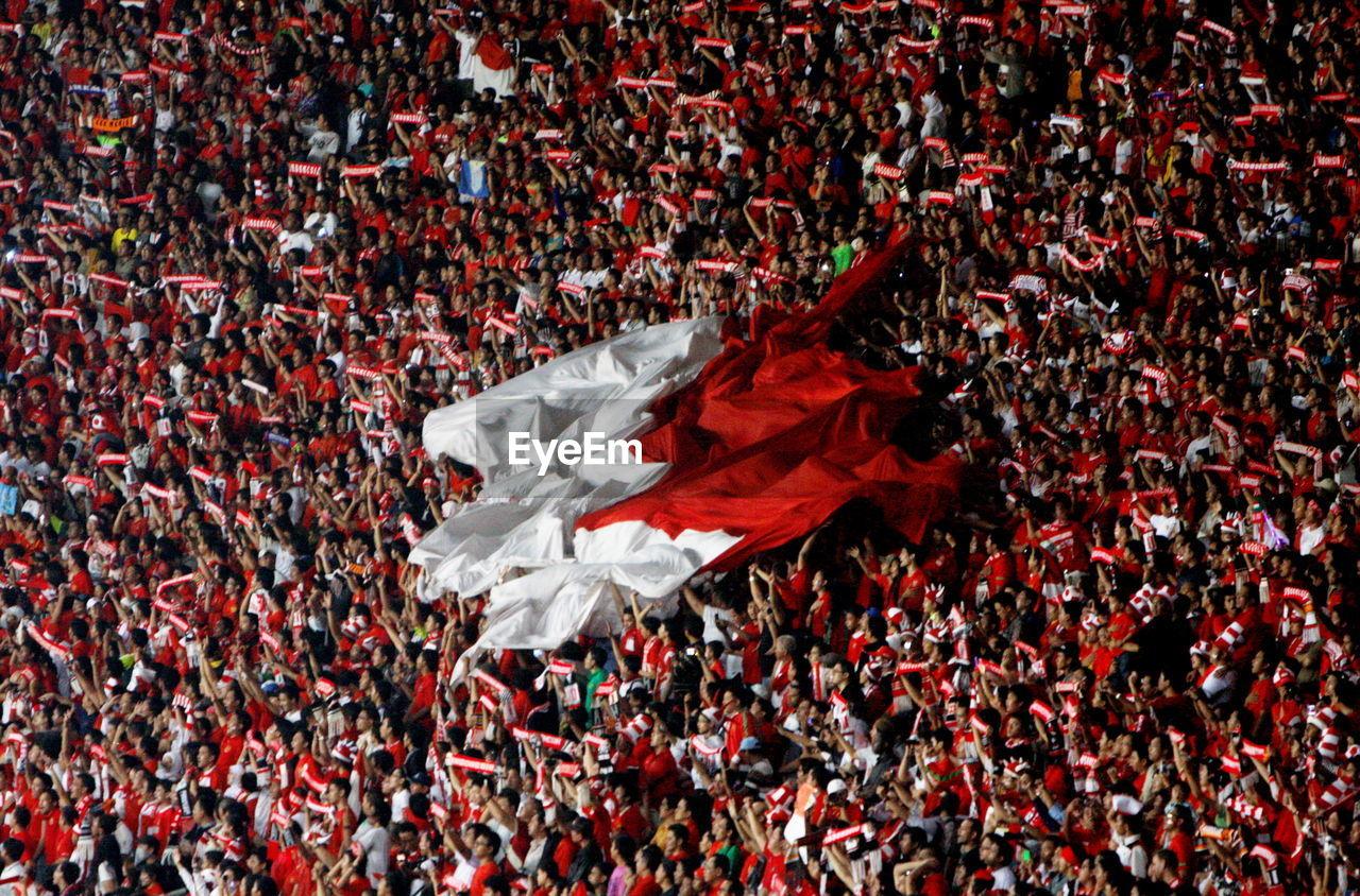 Spectators With Indonesian Flag In Soccer Stadium