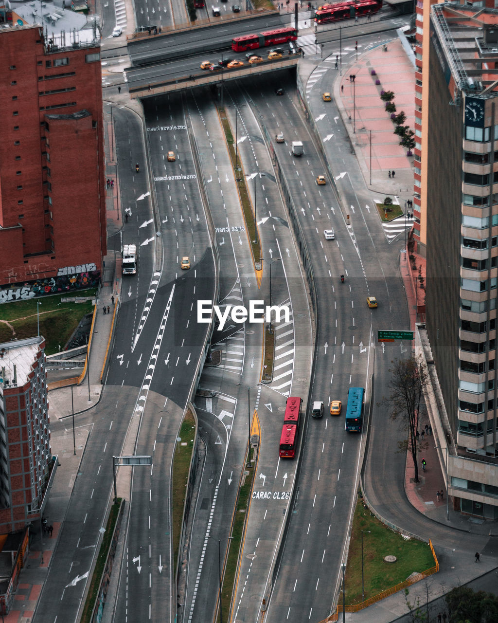 transportation, architecture, mode of transportation, high angle view, built structure, city, road, car, land vehicle, building exterior, motor vehicle, street, sign, traffic, motion, highway, no people, city street, marking, bridge, multiple lane highway, outdoors, cityscape