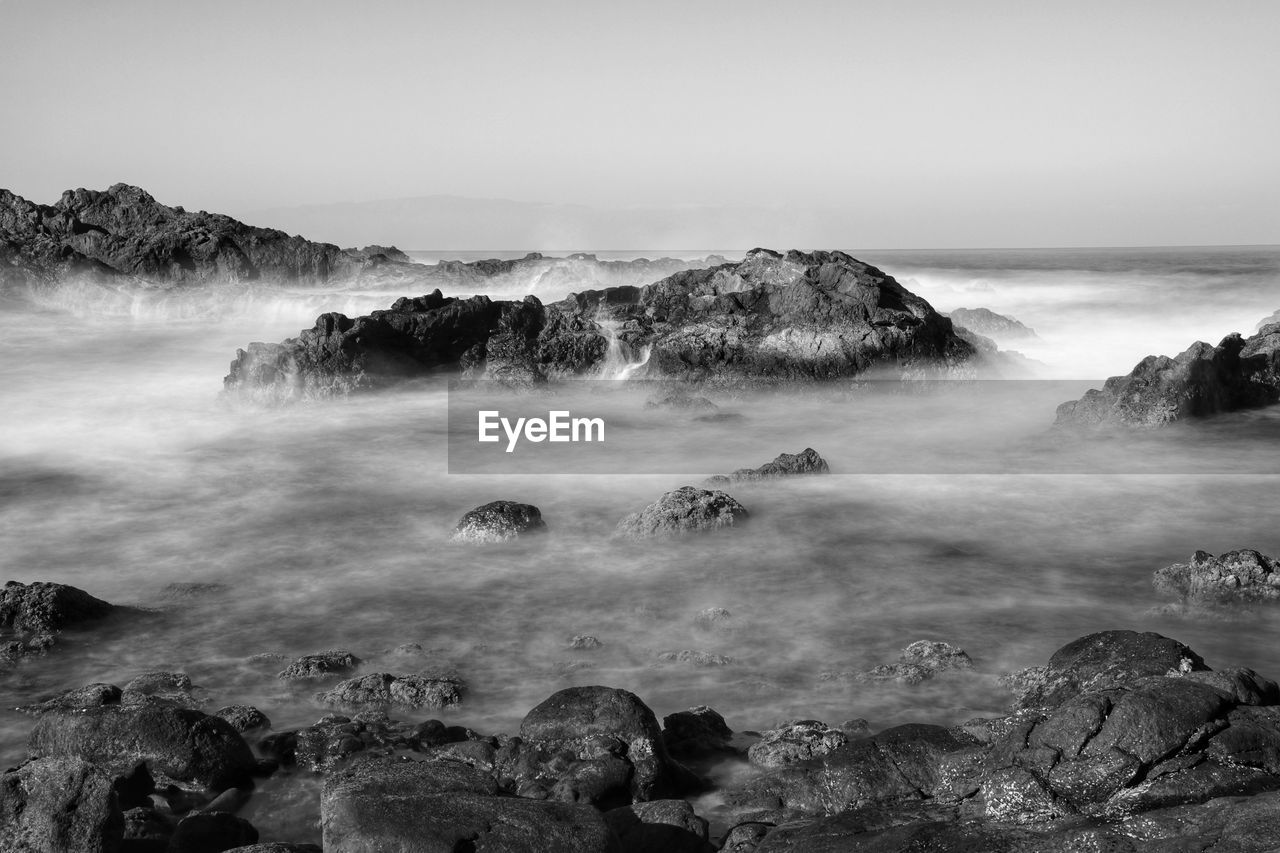 rock, water, beauty in nature, scenics - nature, rock - object, sea, sky, solid, long exposure, motion, nature, tranquility, no people, land, tranquil scene, non-urban scene, blurred motion, day, rock formation, horizon over water, outdoors, power in nature, rocky coastline