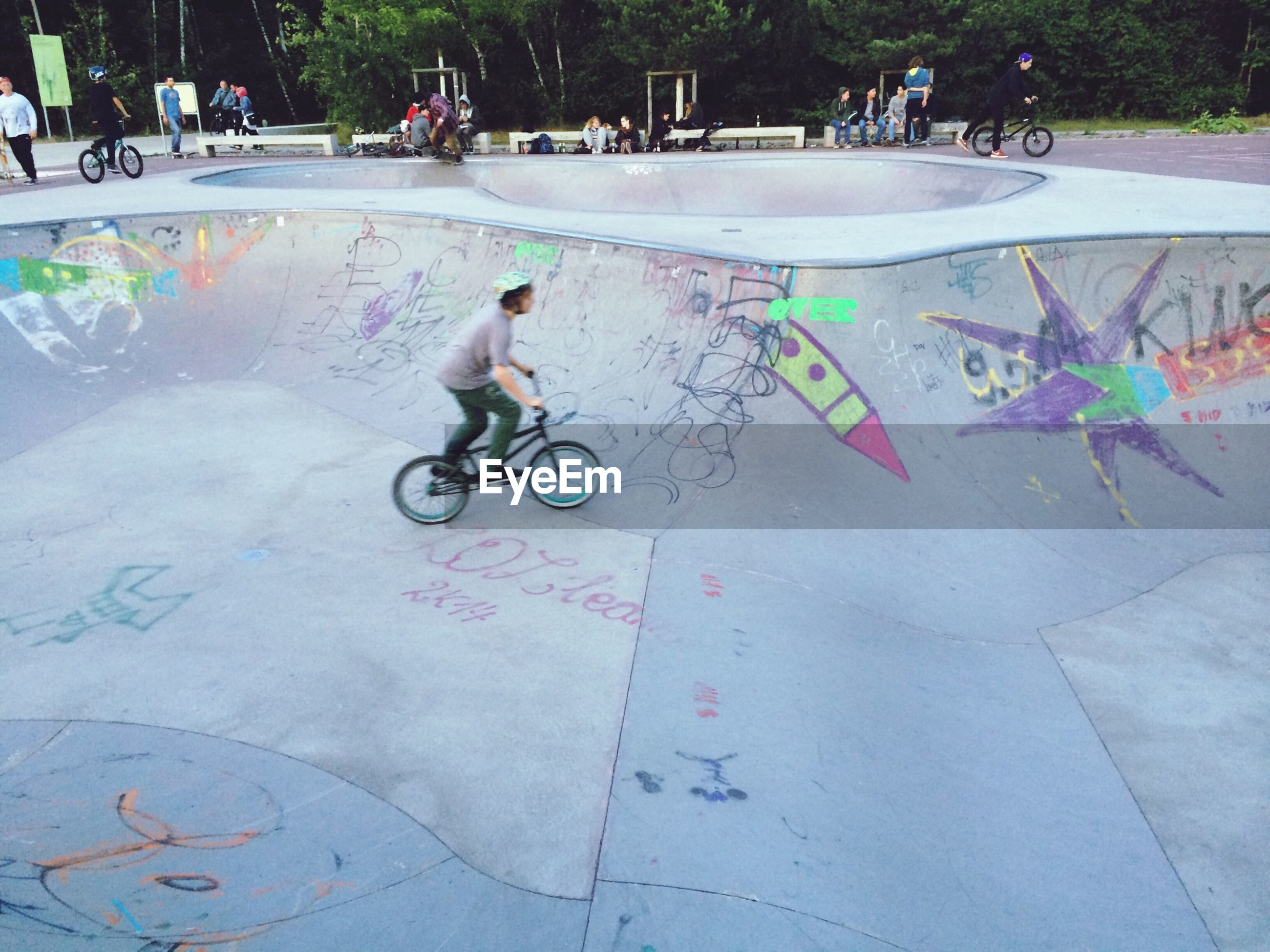 Boy riding bicycle at skateboard park