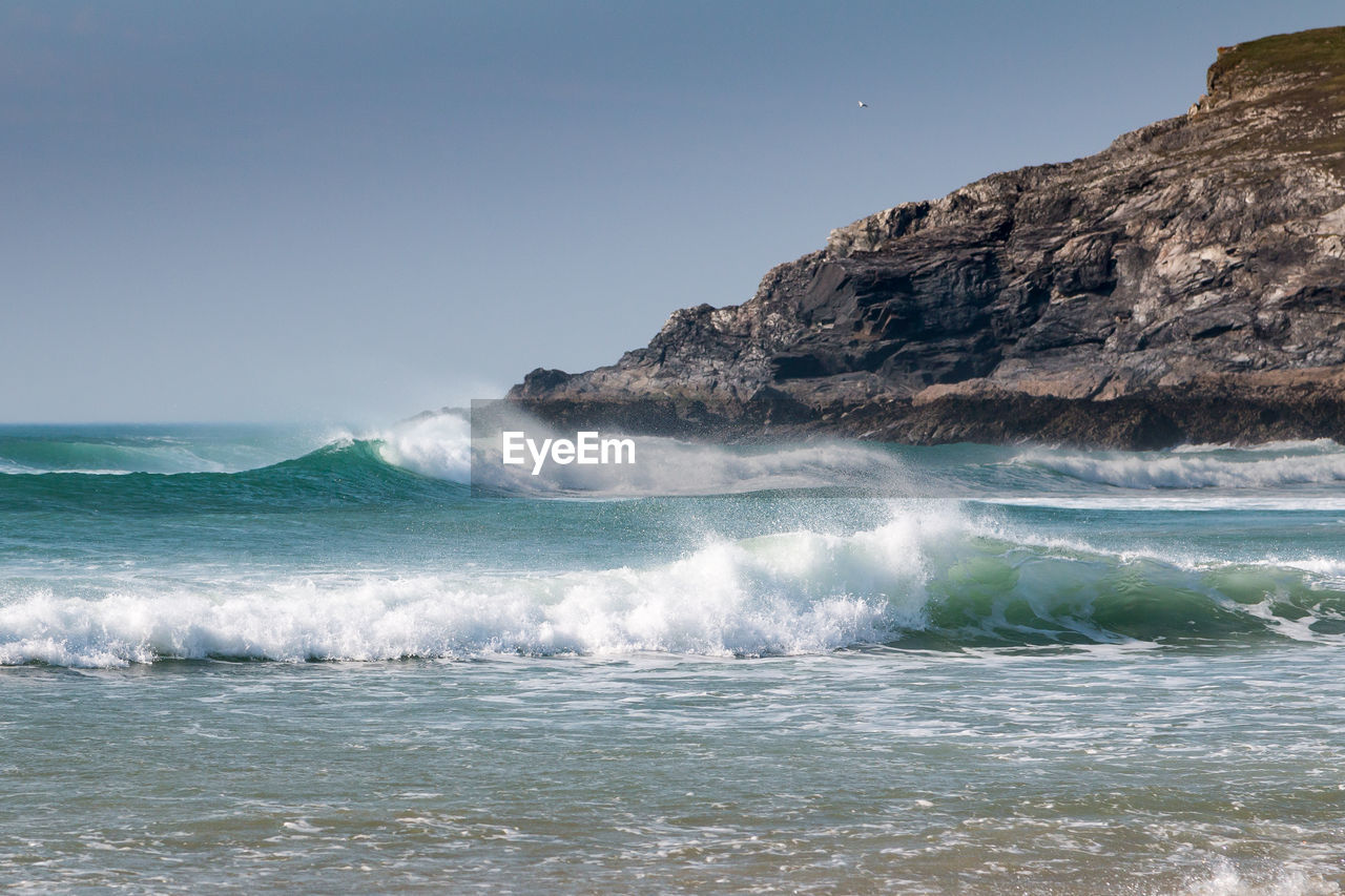 sea, water, sky, motion, beauty in nature, wave, scenics - nature, clear sky, waterfront, sport, nature, land, aquatic sport, day, no people, beach, power in nature, outdoors, horizon over water, flowing water