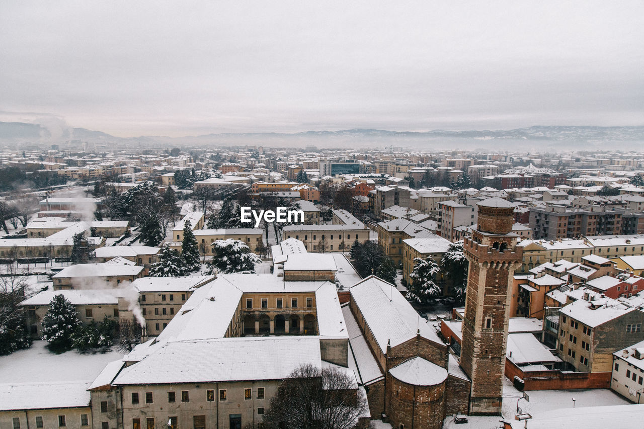 High Angle View Of Houses In City During Winter