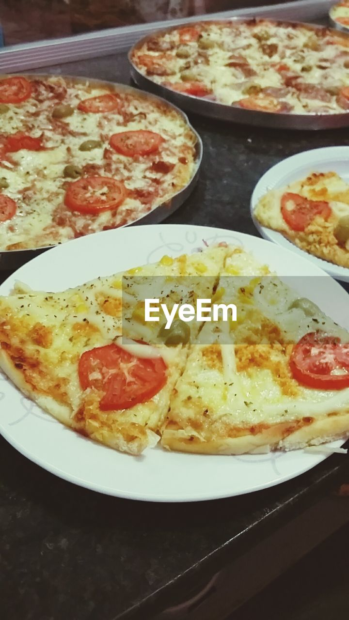 food, food and drink, pizza, plate, ready-to-eat, indoors, no people, italian food, cheese, serving size, freshness, table, unhealthy eating, close-up, meal, omelet, fast food, day