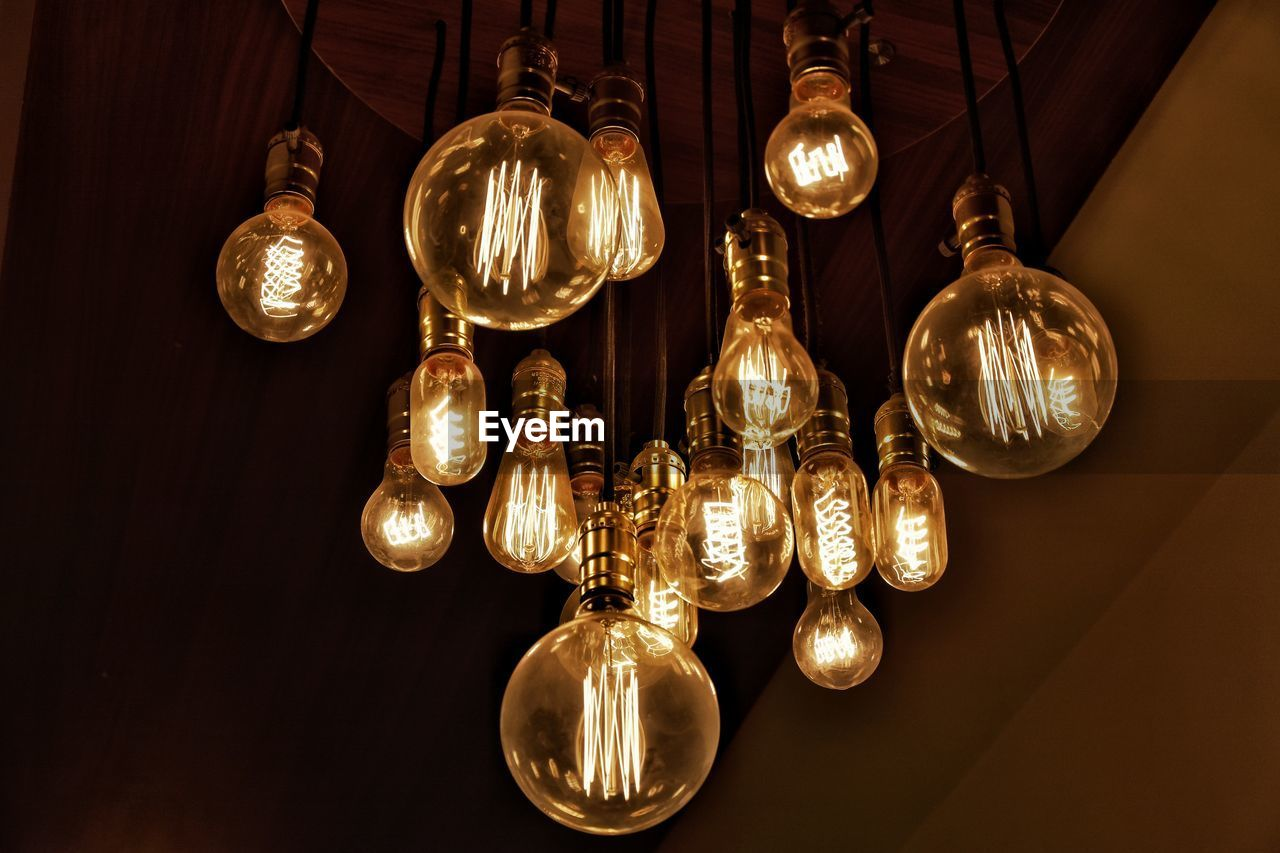 lighting equipment, illuminated, electricity, light, indoors, hanging, glowing, no people, electric light, low angle view, decoration, glass - material, light bulb, close-up, technology, pendant light, shiny, ceiling, light - natural phenomenon, group of objects, electric lamp, luxury, light fixture
