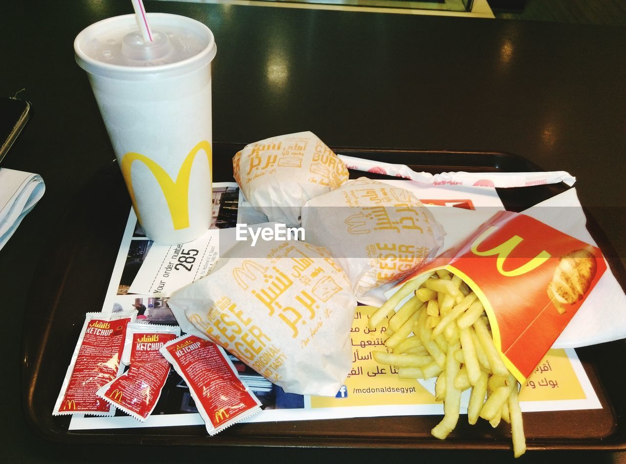 food and drink, high angle view, no people, text, table, food, indoors, close-up, plate, yellow, day, freshness