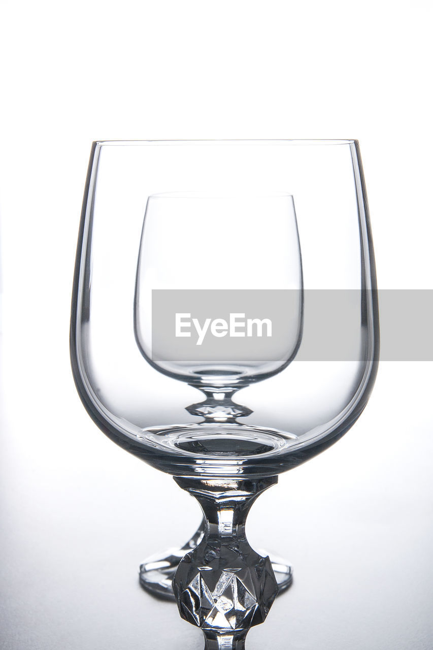 indoors, close-up, studio shot, no people, white background, glass - material, glass, transparent, still life, reflection, single object, household equipment, shiny, drinking glass, wineglass, shape, design, metal, refreshment, clean