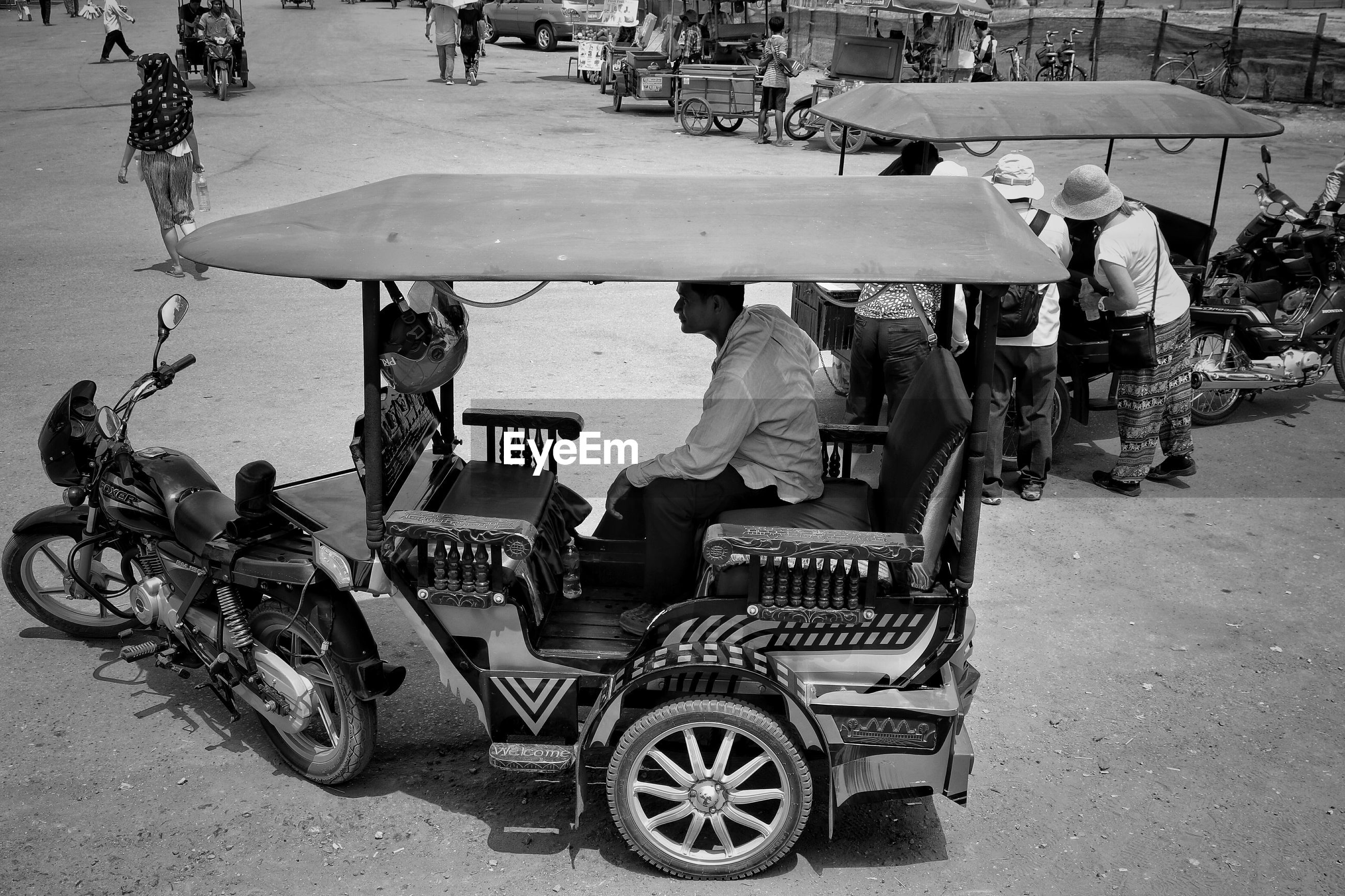 Side view of auto rickshaw on road