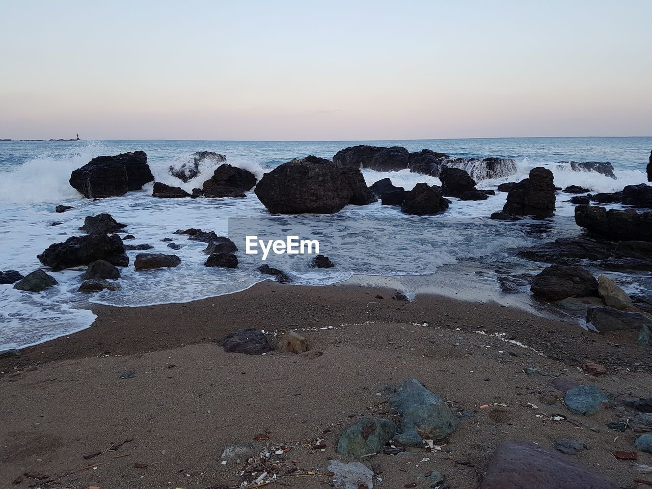 sea, horizon over water, water, nature, beauty in nature, beach, scenics, rock - object, tranquility, tranquil scene, sunset, clear sky, sky, no people, outdoors, sand, wave, day