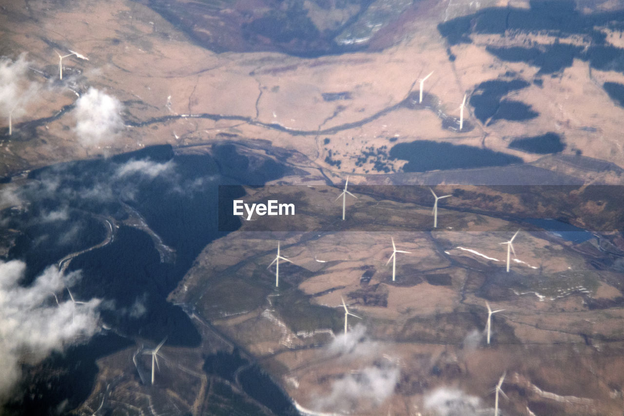 environment, aerial view, beauty in nature, nature, scenics - nature, landscape, no people, day, environmental conservation, turbine, airplane, outdoors, land, wind turbine, field, tranquility, sunlight, renewable energy, air vehicle, flying