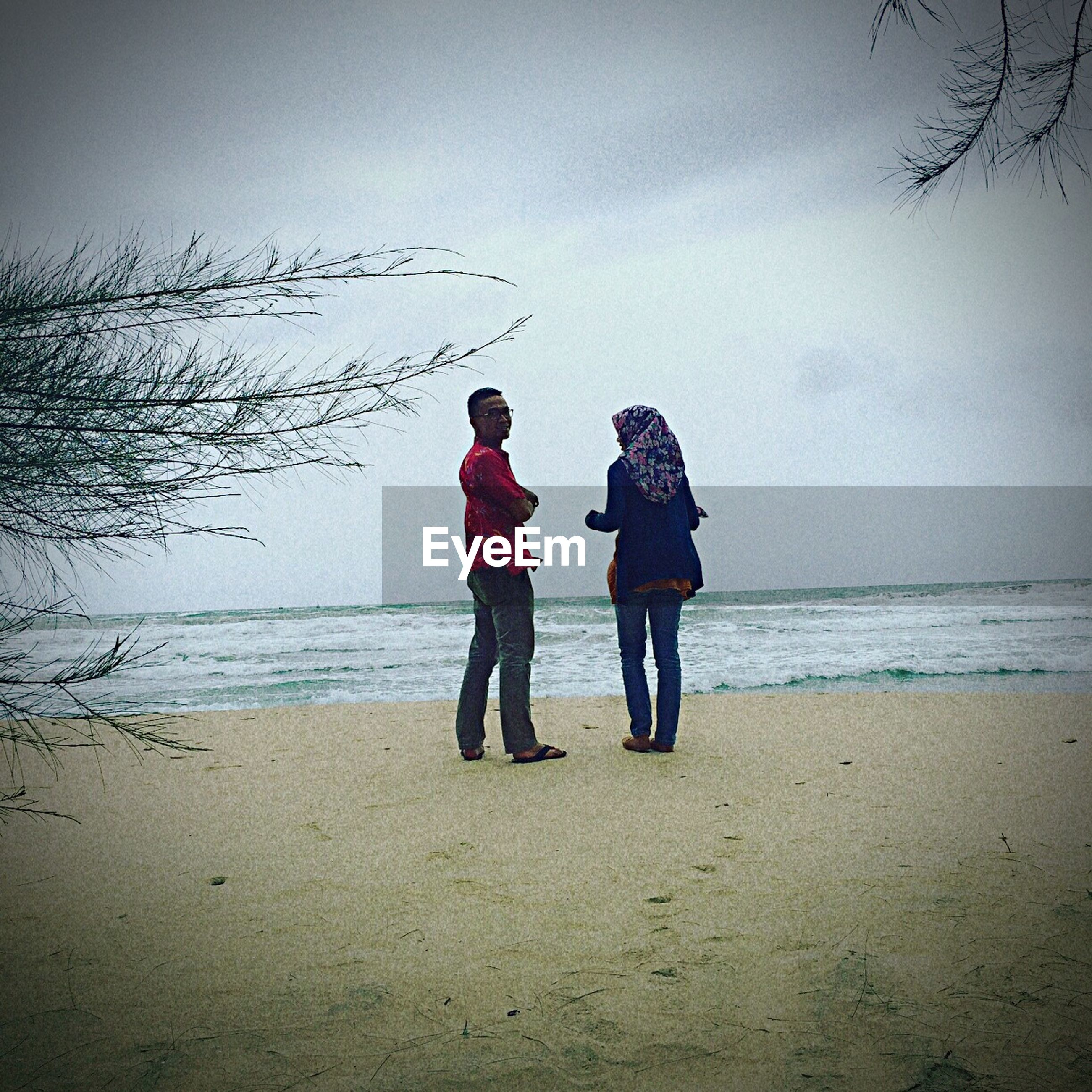 two people, full length, togetherness, beach, friendship, sea, bonding, real people, leisure activity, outdoors, happiness, sand, people, sky, connection, horizon over water, childhood, beauty in nature, day, nature, technology, adult, adults only