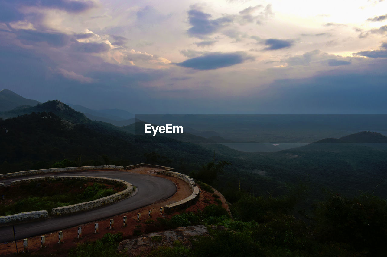 High Angle View Of Road By Mountains Against Sky