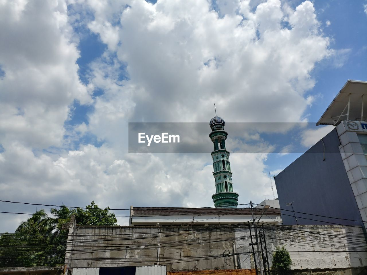 architecture, cloud - sky, building exterior, sky, built structure, low angle view, no people, outdoors, day, city, tree
