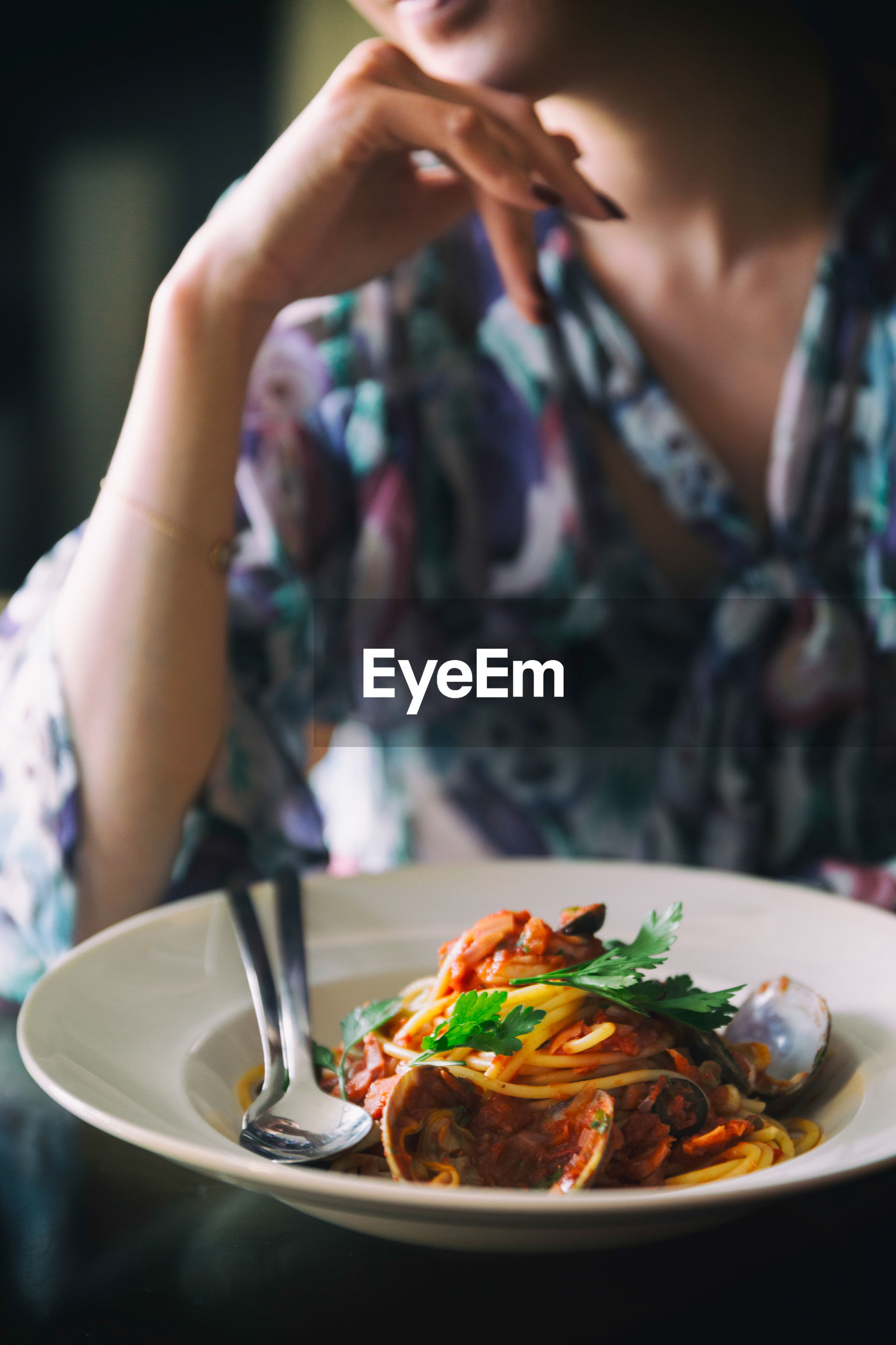 Midsection of woman with meal at table