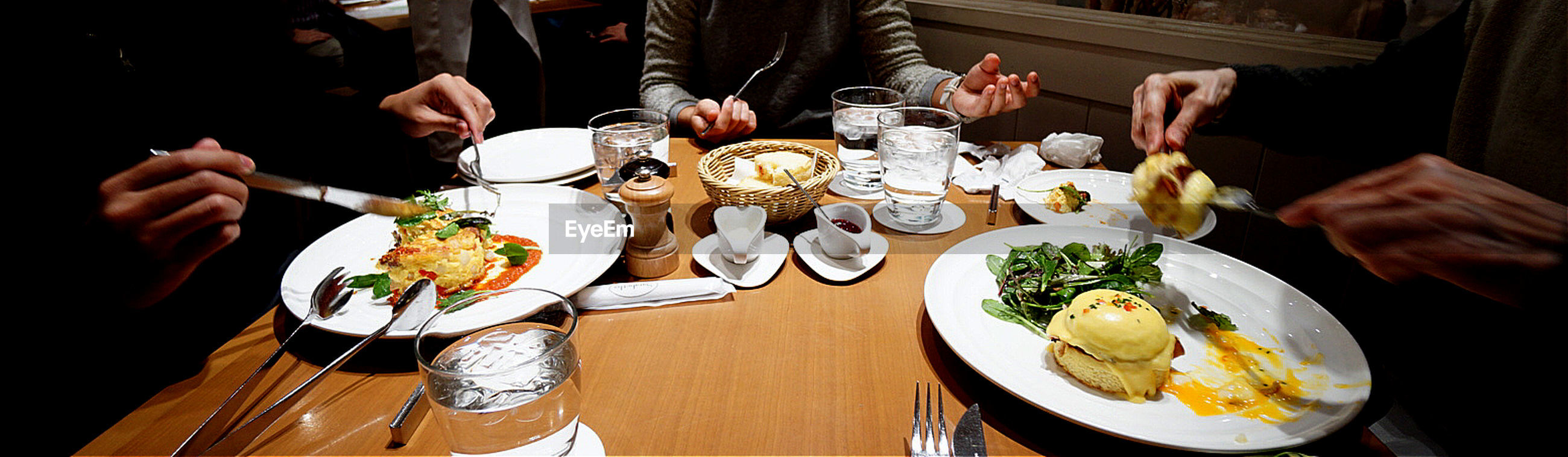People having breakfast at restaurant table