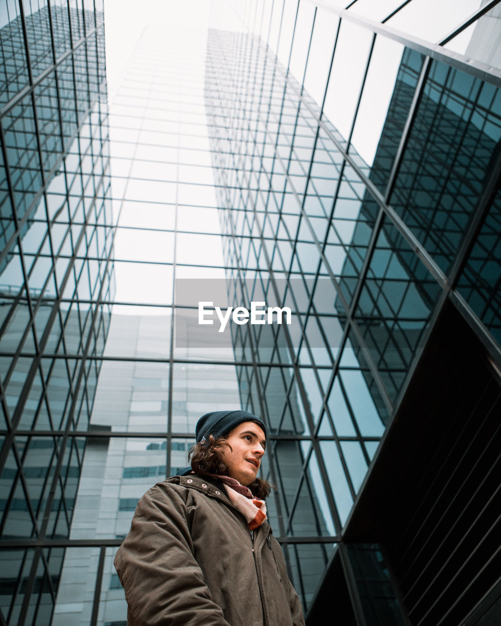 Low Angle View Of Man Against Skyscraper In City