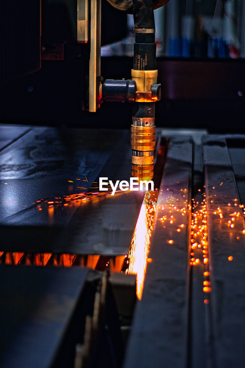 View of illuminated machinery in factory