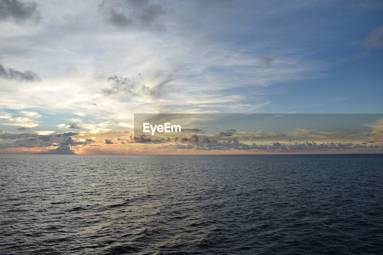 sky, cloud - sky, water, sea, waterfront, scenics - nature, sunset, beauty in nature, tranquility, tranquil scene, nature, horizon over water, horizon, no people, idyllic, remote, outdoors, freedom, seascape