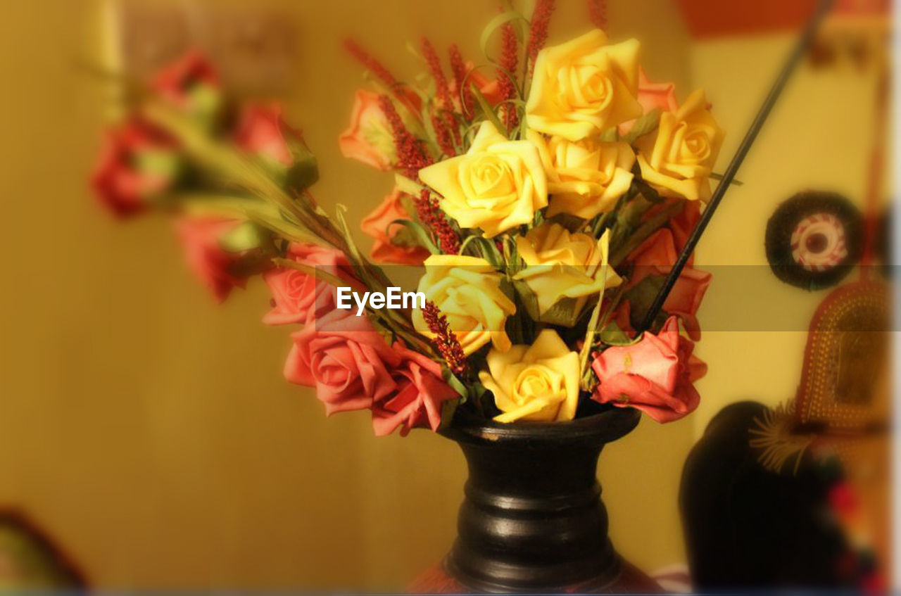 flower, vase, indoors, petal, rose - flower, flower head, flower arrangement, bouquet, fragility, no people, close-up, freshness, beauty in nature, nature, multi colored, day, florist