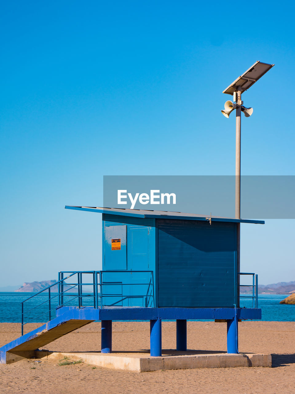 sky, blue, clear sky, nature, land, day, lighting equipment, beach, sunlight, copy space, street light, built structure, no people, outdoors, architecture, horizon, sand, safety, water, technology