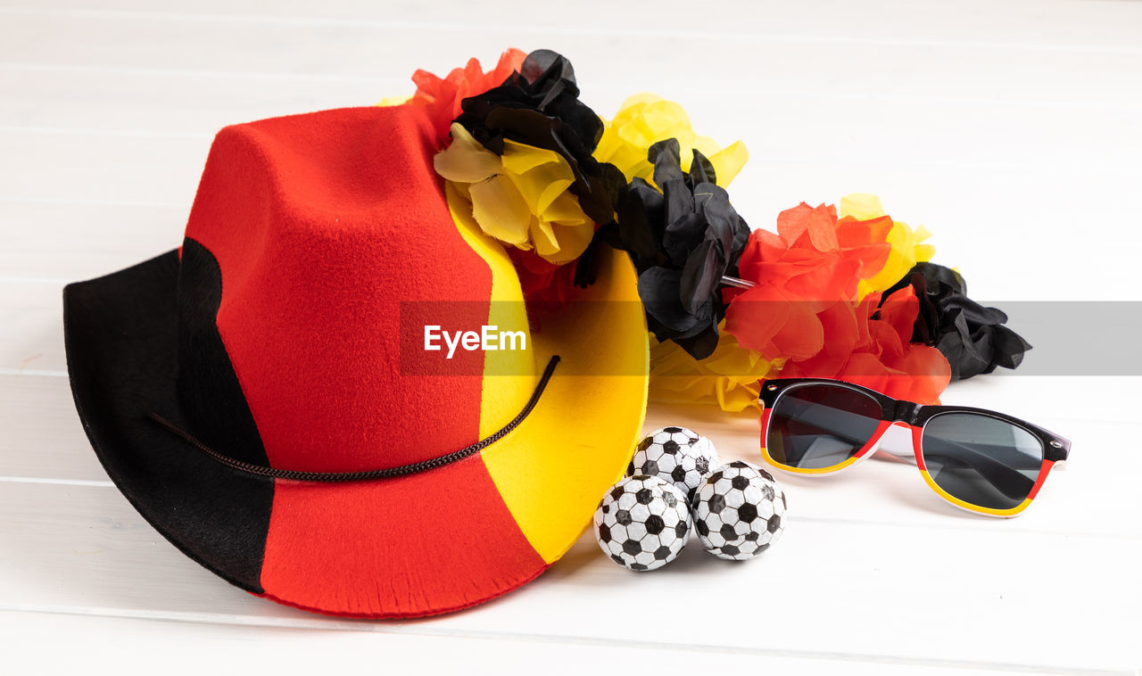 still life, fashion, studio shot, glasses, white background, indoors, no people, sunglasses, red, close-up, personal accessory, black color, shoe, yellow, multi colored, high angle view, large group of objects, orange color, cut out, white color