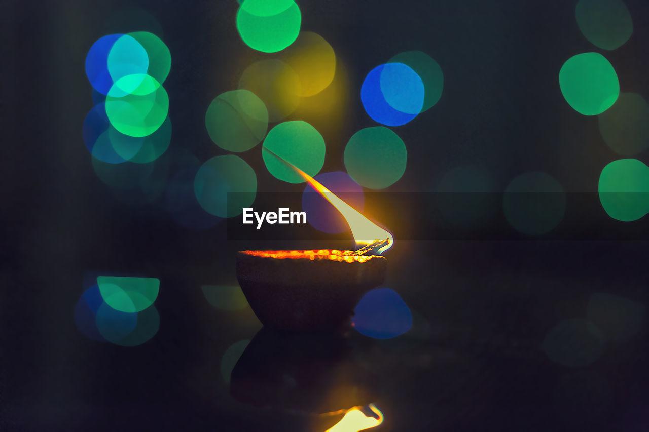 Close-Up Of Illuminated Oil Lamp