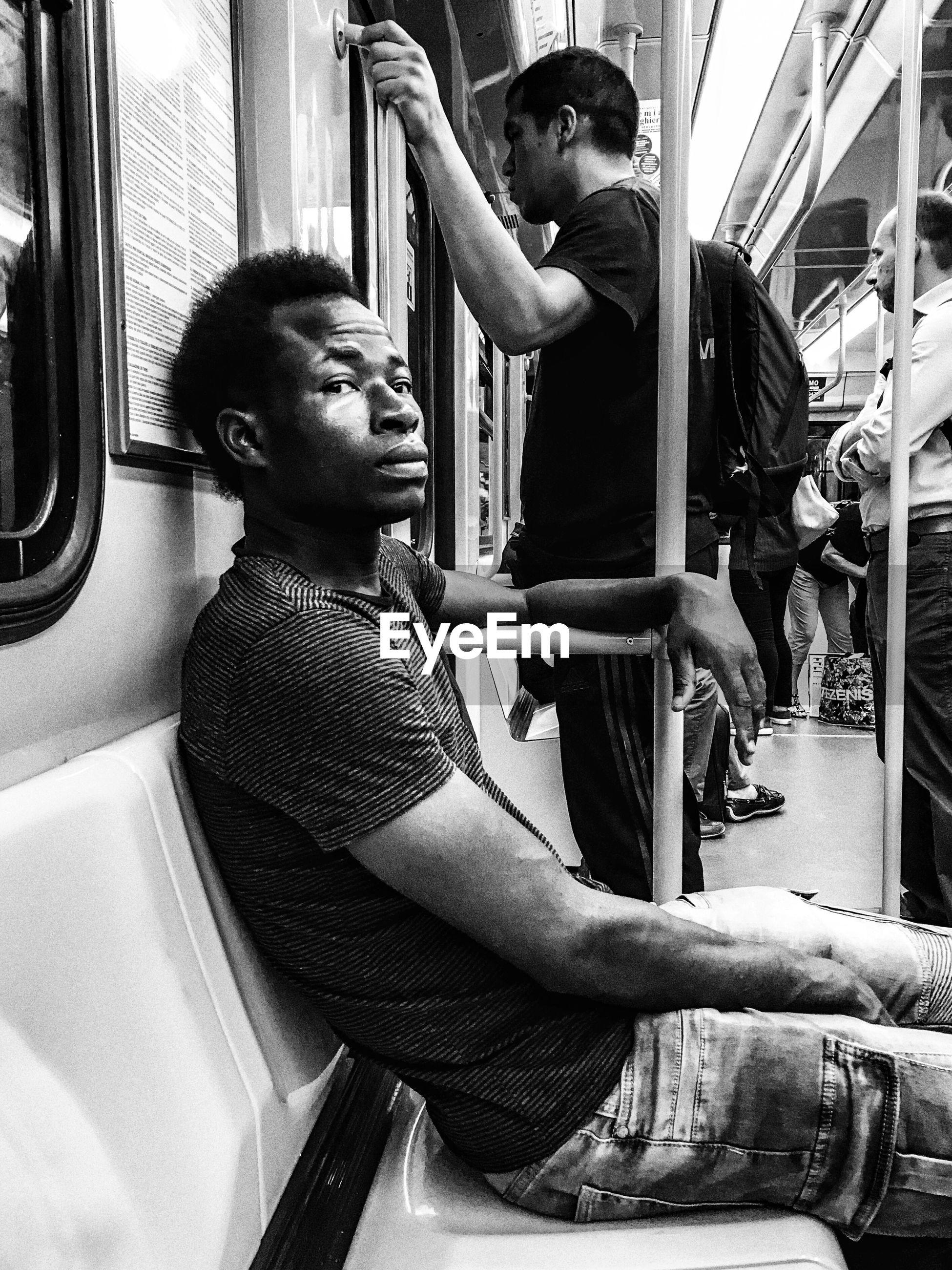 MAN SITTING ON TRAIN WINDOW