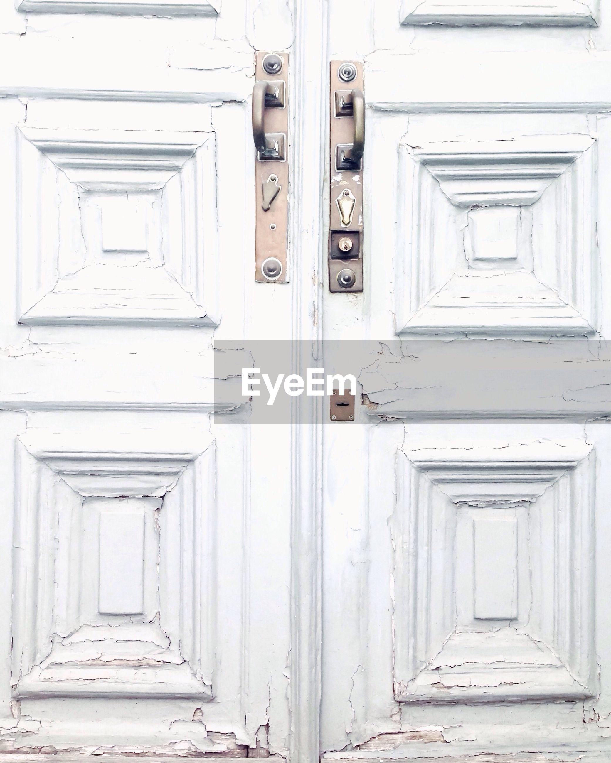 Full frame shot of closed white door