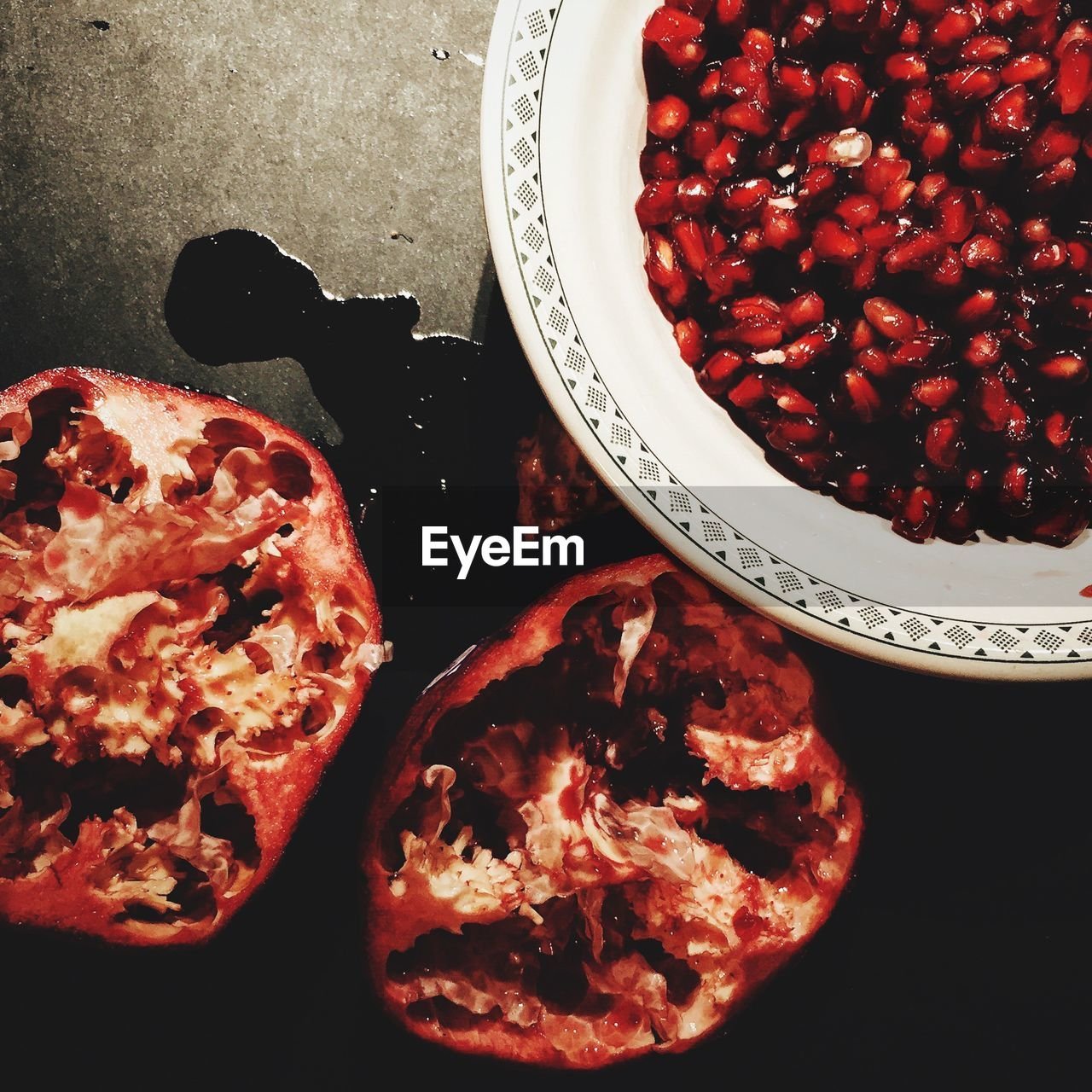 High Angle View Of Pomegranate Seeds In Bowl On Table