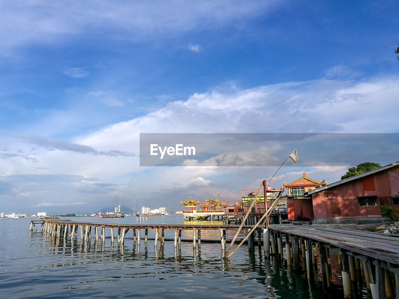 built structure, architecture, water, sky, cloud - sky, building exterior, nature, building, waterfront, no people, reflection, pier, day, wood - material, residential district, outdoors, sea, connection