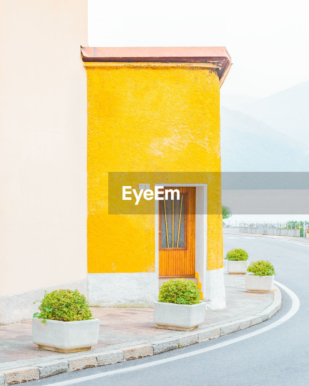 built structure, architecture, no people, yellow, building exterior, day, nature, potted plant, plant, building, outdoors, close-up, wall - building feature, house, wall, freshness, window, healthy eating, orange color, sky